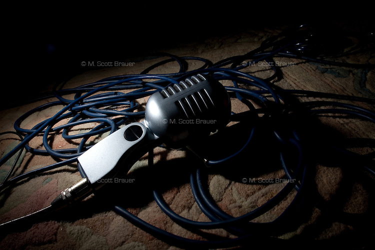A studio microphone sits on a bed of microphone cables in a studio owned by punk musician Duwei of the Chinese band Overdose in Nanjing, China.
