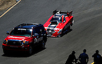 Jul. 17, 2010; Sonoma, CA, USA; The car of NHRA funny car driver Cruz Pedregon is towed back to the pits during qualifying for the Fram Autolite Nationals at Infineon Raceway. Mandatory Credit: Mark J. Rebilas-