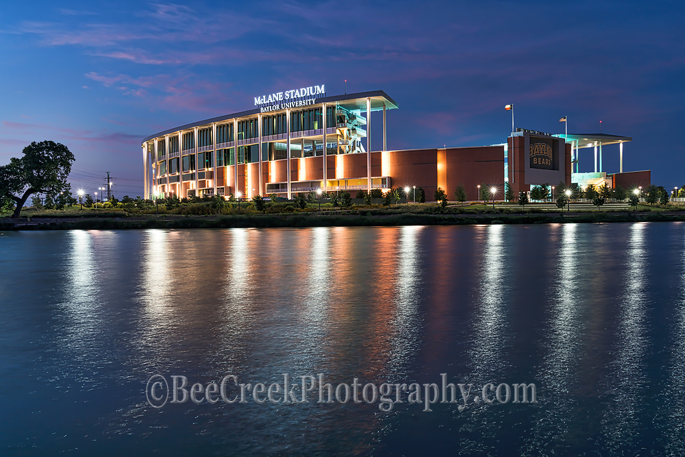 McLane Stadium at Baylor University in Waco after the sunset as the blue hour begins and the light came on.  You can still see  a hint of the pink color still left in the clouds from sunset. We also like the nice reflections that the light brought out on the waters of the brazos river on this evening.