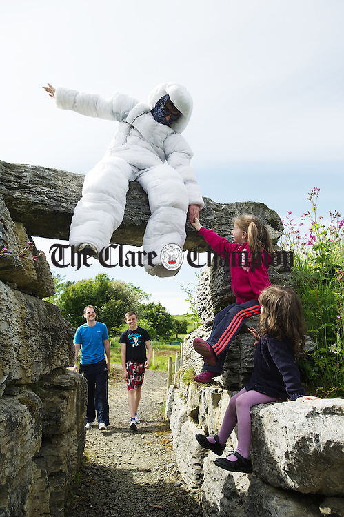 "Doolin Cave mascot  ""Rocky""  greets sisters Grace and Laura Dunne at Doolin Cave ahead of the forthcoming Burren Rocks event which is on 5th 9th June celebrating The Burren and The Cliffs Of Moher Geopark. In the background are John O Donohoe and Nicholas Dunne. Photograph by John Kelly."