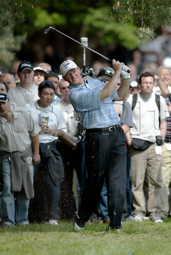 30 May, 2004: South African golfer ERNIE ELS (RSA) looks into the distance after playing from the light rough on the 12th during the second round of the Volvo PGA Championship at Wentworth Photo: Glyn Kirk/Action Plus...golf  player 040528 gallery crowd spectators