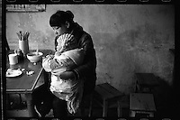 An earthquake survivor and her son eat breakfast at a local restaurant in the newly rebuilt Hongbai township in March, 2011. An 8.0 magnitude earthquake struck China's Sichuan province on May 12, 2008, leaving nearly 90,000 people dead or missing and five million homeless.