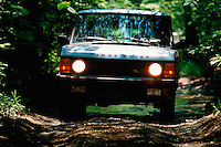 Range Rover on unpaved back road.