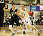 SIOUX FALLS, SD, FEBRUARY 10: Zach Wessels #11 from the University of Sioux Falls drives against Steven Schaefer #24 from Augustana Friday night at the Stewart Center in Sioux Falls. (Photo by Dave Eggen/Inertia)