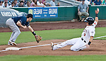Reno Aces Mike Jacobs beats the thow to third as Colorado Sky Sox third baseman Brendon Harris makes the tag during their game on Tuesday night July 24, 2012 at Aces Ballpark in Reno NV.