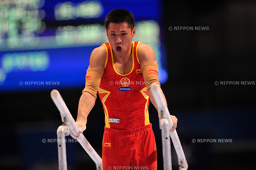 Zhang Chenglong (CHN),..OCTOBER 10, 2011 - Artistic Gymnastics : FIG World Championships Tokyo 2011 Artistic Gymnastics Men's Qualification during Parallel bars at Tokyo Metropolitan Gymnasium, Tokyo, Japan. (Photo by Jun Tsukida/AFLO SPORT) [0003]..