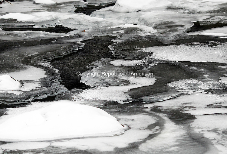 Middlebury, CT- 25 January 2014-012514CM23-  COUNTRY LIFE BANNERS---- Water flows through ice down a river at Hop Brook in Middlebury on Saturday.   Christopher Massa Republican-American