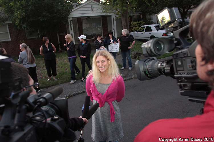 Kelly Page of Dogs Deserve Better speaks to the press outside the home of a dog locked in a basement in Shoreline, WA on September 28, 2010.  ..King County Animal Control who has been called to this house on animal cruelty complaints for over seven years, has again been out there a couple of times in the past week but has failed to do anything to help the dog.  It is case # 10-06739. (photo © Karen Ducey 2010). .