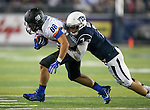 Nevada's Duran Workman (7) tackles Boise State's Jake Roh (88) during the second half of an NCAA college football game in Reno, Nev., on Saturday, Oct. 4, 2014. Boise State won 51-46. (AP Photo/Cathleen Allison)
