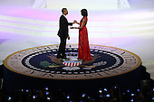 United States President Barack Obama (L) dances with first lady Michelle Obama at the Commander-in-Chief Ball on January 21, 2013 in Washington, DC. Pres. Obama was sworn-in for his second term as president during a public ceremonial inauguration earlier in the day.  .Credit: Justin Sullivan / Pool via CNP