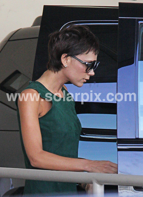 **ALL ROUND PICTURES FROM SOLARPIX.COM**.**WORLDWIDE SYNDICATION RIGHTS**.**NO PUBLICATION IN AUSTRALIA, NEW ZEALAND, DENMARK, GERMANY OR USA**.Victoria Beckham shows the strain as she prepares herself for the move to Milan with her husband. Widely thought to have made the decision to join her husband in Milan to stop Italian babes making a play for his Goldenballs, Victoria, 34, has been worrying about David straying without her nearby...Victoria tried to divert herself from the pressure of the upcoming move by spending the day with her young son shopping on Rodeo Drive, in Beverly Hills. Victoria and her son Cruz are seen leaving the Dolce & Gabbana store via the back door, whilst Victoria seems to have promised Cruz that Christmas will come early this year, as he is already wearing his Santa hat...Victoria, who struggles with her weight more in times of stress, appears extremely thin once again, and her hands appear to be very bony as she uses her mobile phone as they drive away...This pic: Victoria Beckham..JOB REF: 7851 LAP (MDAS)       DATE: 11_11_2008.**MUST CREDIT SOLARPIX.COM OR DOUBLE FEE WILL BE CHARGED* *UNDER NO CIRCUMSTANCES IS THIS IMAGE TO BE REPRODUCED FOR ANY ONLINE EDITION WITHOUT PRIOR PERMISSION*