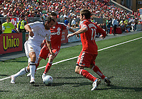 06 June 2009: Los Angeles Galaxy midfielder Chris Klein #7 battles for the ball with Toronto FC midfielder Sam Cronin #2 and Toronto FC midfielder Jim Brennan #11 during MLS at BMO Field Toronto in a game between LA Galaxy and Toronto FC. .The Galaxy  won 2-1.
