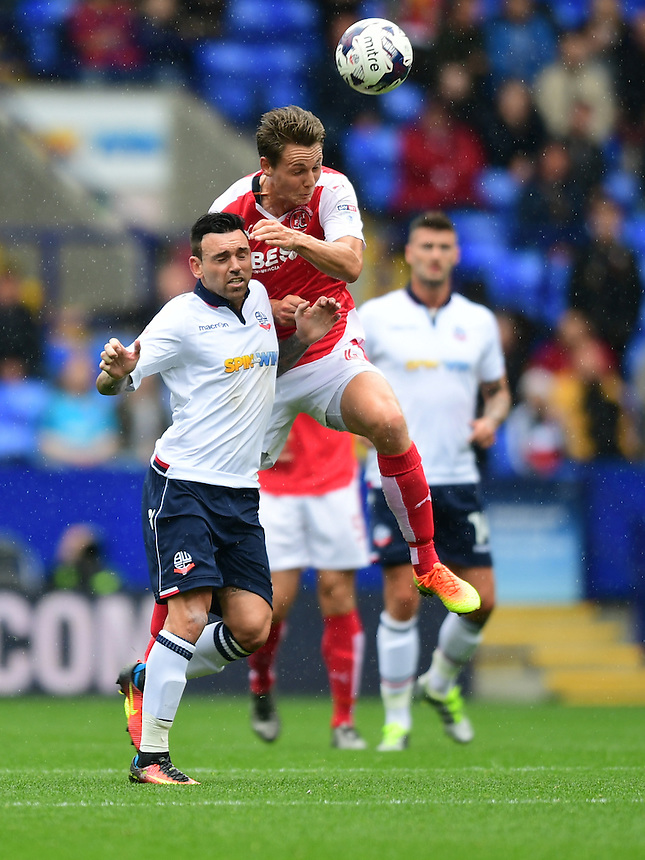 Fleetwood Town's Eggert Jonsson vies for possession with Bolton Wanderers's Mark Davies<br /> <br /> Photographer Chris Vaughan/CameraSport<br /> <br /> Football - The EFL Sky Bet League One - Bolton Wanderers v Fleetwood Town - Saturday 20 August 2016 - Macron Stadium - Bolton<br /> <br /> World Copyright &copy; 2016 CameraSport. All rights reserved. 43 Linden Ave. Countesthorpe. Leicester. England. LE8 5PG - Tel: +44 (0) 116 277 4147 - admin@camerasport.com - www.camerasport.com