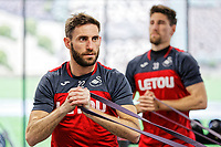 (L-R) Angel Rangel and Federico Fernandez exercise in the gym during the Swansea City Training Session and Press Conference at The Fairwood Training Ground, Wales, UK. Thursday 29 March 2018