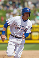 Round Rock Express third baseman Mike Olt #20 runs to third base against the New Orleans Zephyrs in the Pacific Coast League baseball game on April 21, 2013 at the Dell Diamond in Round Rock, Texas. Round Rock defeated New Orleans 7-1. (Andrew Woolley/Four Seam Images).
