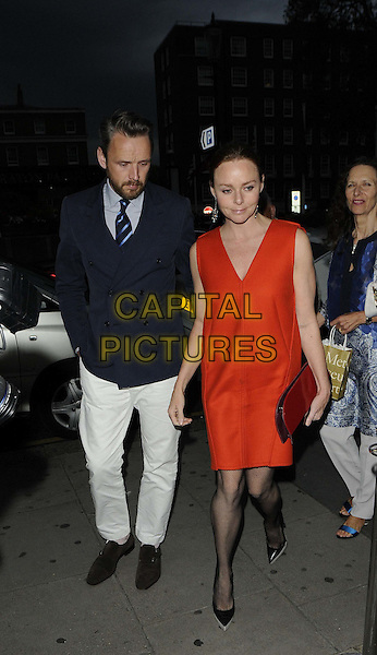 Alasdhair Willis & Stella McCartney.The Jax Coco, a new coconut water brand,  launch party, Harvey Nichols London, Knightsbridge, London, England..June 25th, 2012.full length blue jacket beard facial hair white trousers red dress clutch bag orange married husband wife .CAP/CAN.©Can Nguyen/Capital Pictures.