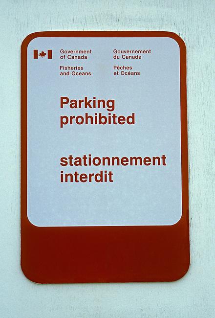 Parking prohibited stationnement interdit bilingual sign fishing port in Shippagan New Brunswick Province Canada North America