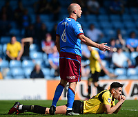 Bolton Wanderers' Conor Wilkinson reacts after missing a chance in the first half under pressure from Scunthorpe United's David Mirfin<br /> <br /> Photographer Chris Vaughan/CameraSport<br /> <br /> The EFL Sky Bet League One - Scunthorpe United v Bolton Wanderers - Saturday 8th April 2017 - Glanford Park - Scunthorpe<br /> <br /> World Copyright &copy; 2017 CameraSport. All rights reserved. 43 Linden Ave. Countesthorpe. Leicester. England. LE8 5PG - Tel: +44 (0) 116 277 4147 - admin@camerasport.com - www.camerasport.com