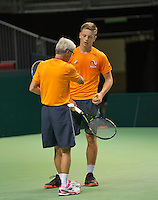 Swiss, Genève, September 14, 2015, Tennis,   Davis Cup, Swiss-Netherlands, practise Dutch team, Tim van Rijthoven gets instructions from coach Martin Bohm<br /> Photo: Tennisimages/Henk Koster