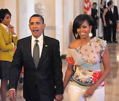 """Washington, D.C. - May 12, 2009 -- United States President Barack Obama and first lady Michelle Obama walk to the East Room for """"An Evening of Poetry, Music and the Spoken Word in the East Room of the White House in Washington, DC on Tuesday, May 12, 2009..Credit: Ron Sachs / Pool via CNP"""