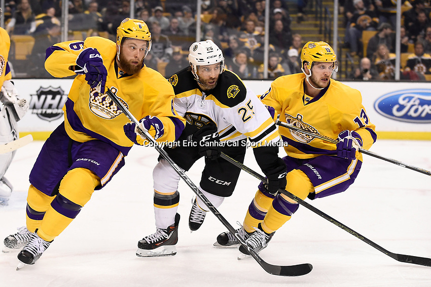 Tuesday, February 9, 2016: Boston Bruins center Max Talbot (25) works between Los Angeles Kings defenseman Jake Muzzin (6) and left wing Kyle Clifford (13) during the National Hockey League game between the Los Angeles Kings and the Boston Bruins, held at TD Garden, in Boston, Massachusetts. The Kings defeat the Bruins 9-2. Eric Canha/CSM
