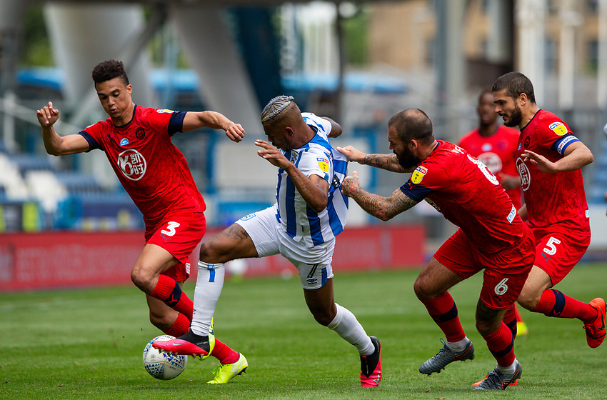 Huddersfield Town's Juninho Bacuna battles with Wigan Athletic's Danny Fox and Antonee Robinson<br /> <br /> Photographer Alex Dodd/CameraSport<br /> <br /> The EFL Sky Bet Championship - Huddersfield Town v Wigan Athletic - Saturday 20th June 2020 - John Smith's Stadium - Huddersfield <br /> <br /> World Copyright © 2020 CameraSport. All rights reserved. 43 Linden Ave. Countesthorpe. Leicester. England. LE8 5PG - Tel: +44 (0) 116 277 4147 - admin@camerasport.com - www.camerasport.com