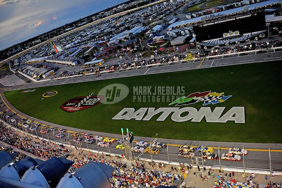 Jul. 2, 2010; Daytona Beach, FL, USA; NASCAR Nationwide Series drivers Brad Keselowski (22) and teammate Parker Kligerman (26) lead the field at the green flag during the Subway Jalapeno 250 at Daytona International Speedway. Mandatory Credit: Mark J. Rebilas-