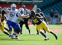September 17, 2011:  California's Ernest Owusu works his way around Presbyterian's Max Travis during a game at AT&T Park, San Francisco, Ca    California Defeated Presbyterian 63 - 12