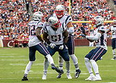 New England Patriots linebacker Ja'Whaun Bentley (51) celebrates with teammates free safety Devin McCourty (32), middle linebacker Kyle Van Noy (53) and cornerback Jason McCourty (30) following his hard tackle of Washington Redskins running back Chris Thompson (25) in the fourth quarter of the game at FedEx Field in Landover, Maryland on Sunday, October 6, 2019.  The Patriots won the game 33 - 7.<br /> Credit: Ron Sachs / CNP