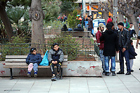 Pictured: Children and adult migrants in Victoria Square Wednesday 09 March 2016<br /> Re: Migrants at Victoria Square, in central Athens, Greece.