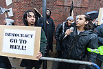 © Joel Goodman - 07973 332324 - all rights reserved . 11/11/2010 . London , UK . Afsor Ali , also known as Abu Assadullah (right) . Muslims Against Crusades hold a demonstration and burn a poppy on the anniversary of Armistice Day , at Kensington Gore , opposed by a demonstration of nationalist groups including the English Defence League ( EDL ) . Photo credit : Joel Goodman
