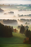 Autumn morning fog clears from rural landscape of Allgaeu region near Eisenberg, Bavaria, Germany