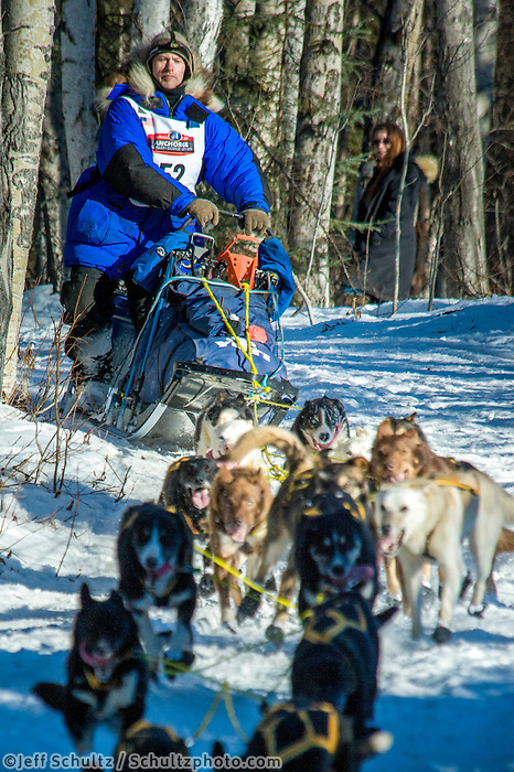Tore Albrigtsen and team run down the trail on Long Lake shortly after leaving the re-start in Willow, Alaska on Sunday, March 6th during the 2016 Iditarod race. Photo by Joshua Borough/SchultzPhoto.com