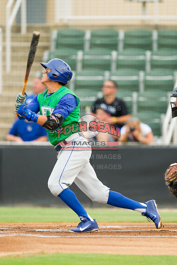 Mark Threlkeld (26) of the Lexington Legends follows through on his swing against the Kannapolis Intimidators at CMC-Northeast Stadium on July 30, 2013 in Kannapolis, North Carolina.  The Legends defeated the Intimidators 1-0.  (Brian Westerholt/Four Seam Images)