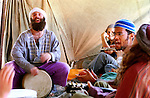 Settlers sing and play music in a tent, during a religious music festival, conducted in the Israeli settlement of Elazar, West Bank.