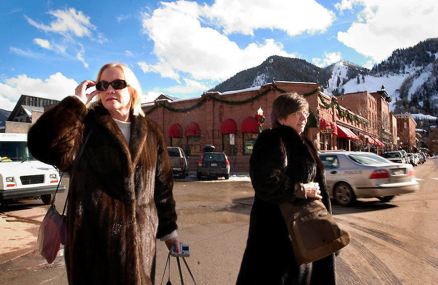 "Sandra Powers, left, and Sharon Schach of Nashville, TN, shop in downtown Aspen, CO Tuesday afternoon. Both have been visiting to Aspen for the past 15-years. According to Mrs. Schach, ""I don't even ski, but there's something about this place that makes me feel wonderful."" According to  Mrs. Powers, ""I broke my leg 6-years ago on Sheer Bliss (a local ski run). I keep coming back even though I don't ski anymore."" Michael Brands for The New York Times."