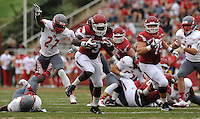 NWA Media/ANDY SHUPE - Arkansas running back Alex Collins (3) carries the ball ahead of Nicholls defensive back Byron Cobb (27) during the first quarter Saturday, Sept. 6, 2014, at Razorback Stadium in Fayetteville