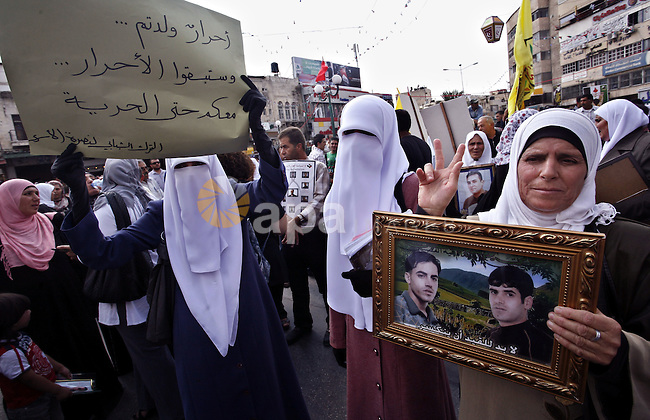 Palestinians take part in a protest in the West Bank city of Nablus on October 3, 2011, to show their solidarity with Palestinian prisoners held in Israeli jails. On Wednesday, Palestinian prisoners in Israel went on a hunger strike in a call to ease their plight. Photo by Wagdi Eshtayah