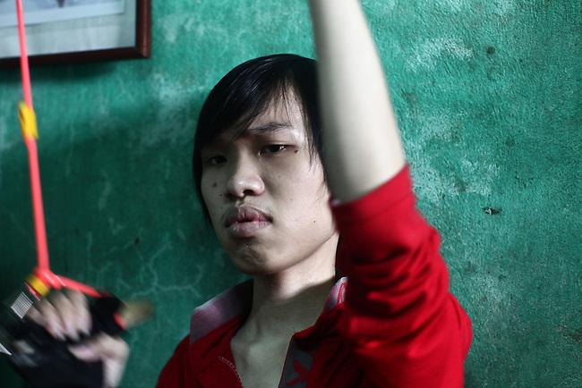 La Thanh Nghia, 18, grimaces slightly as he does physical therapy with his mother at their home near Da Nang, Vietnam. Nghia, and his brother Toan, 21, are third generation victims of dioxin exposure, the result of the U.S. military's use of Agent Orange and other herbicides during the Vietnam War more than 40 years ago. The brothers were born healthy, but began to suffer from muscular dystrophy and other problems as they grew older. They are now confined at home as their bodies and lives waste away. The Vietnam Red Cross estimates that 3 million Vietnamese suffer from illnesses related to dioxin exposure, including at least 150,000 people born with severe birth defects since the end of the war. The U.S. government is paying to clean up dioxin-contaminated soil at the Da Nang airport, which served as a major U.S. base during the conflict. But the U.S. government still denies that dioxin is to blame for widespread health problems in Vietnam and has never provided any money specifically to help the country's Agent Orange victims. Jan. 5, 2013.