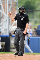 Home plate umpire Matt Carlyon makes a call during a game between the Mahoning Valley Scrappers and Jamestown Jammers  on June 16, 2014 at Russell Diethrick Park in Jamestown, New York.  Mahoning Valley defeated Jamestown 2-1.  (Mike Janes/Four Seam Images)