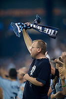 A Sporting Kansas City fans cheers for his team during the game at Livestrong Sporting Park in Kansas City, Kansas.   Sporting Kansas City won the Lamar Hunt U.S. Open Cup on penalty kicks after tying the Seattle Sounders in overtime.