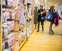 Shoppers in the Uniqlo store on Fifth Avenue in New York on Thursday, March 24, 2016 browse the merchandise in the collaboration between Uniqlo and Liberty London, a company known mostly for its distinctive floral patterned fashions. (©Richard B. Levine)