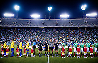 Mexican and Colombian soccer players line up for their respective national anthems before an exhibition game at the Cotton Bowl in Dallas, Texas, USA, Wednesday, Sept., 30, 2009. Colombia won the game 2-1, which was played as the second game of a double header after an FC Dallas soccer game in an attempt by Major League Soccer to draw a new crowd of hispanic people to the sport in the US...PHOTOS/ MATT NAGER