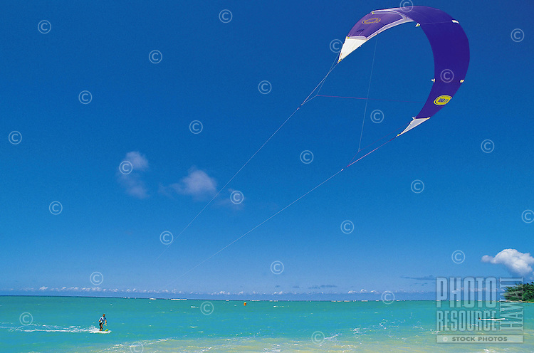 One man kitesurfing in open ocean off the northern coast of Maui