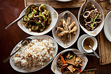 PHILIPPINES, Palawan, Puerto Princesa, table loaded with amazing dishes at the Badjao Seafood Restaurant
