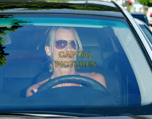 NICOLLETTE SHERIDAN.Spotted out and about in West Hollywood, Los Angeles, California, USA, 28 August 2006..portrait headshot sunglasses driving car.Ref: ADM/JL.www.capitalpictures.com.sales@capitalpictures.com.©Jackson Lee/AdMedia/Capital Pictures.