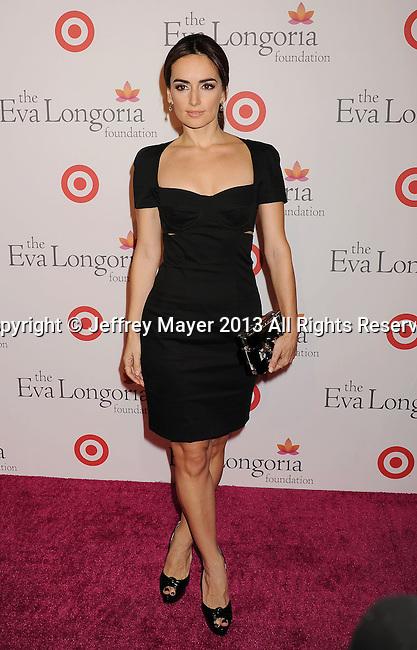 HOLLYWOOD, CA- SEPTEMBER 28: Actress Ana de la Reguera arrives at the Eva Longoria Foundation Dinner at Beso restaurant on September 28, 2013 in Hollywood, California.
