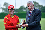 Wu Juan of China receives a prize during their ICC 2016 Women's World Cup Asia Qualifier match between Hong Kong and China on 14 October 2016 at Hong Kong Cricket Club in Hong Kong, China. Photo by Marcio Machado / Power Sport Images