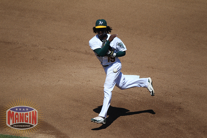 OAKLAND, CA - SEPTEMBER 7:  Jemile Weeks #19 of the Oakland Athletics makes a play at second base against the Kansas City Royals during the game at O.co Coliseum on September 7, 2011 in Oakland, California. Photo by Brad Mangin