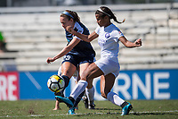 Sanford, FL - Saturday Oct. 14, 2017:  A Courage player shoots past the extended leg of an opponent during a US Soccer Girls' Development Academy match between Orlando Pride and NC Courage at Seminole Soccer Complex. The Courage defeated the Pride 3-1.